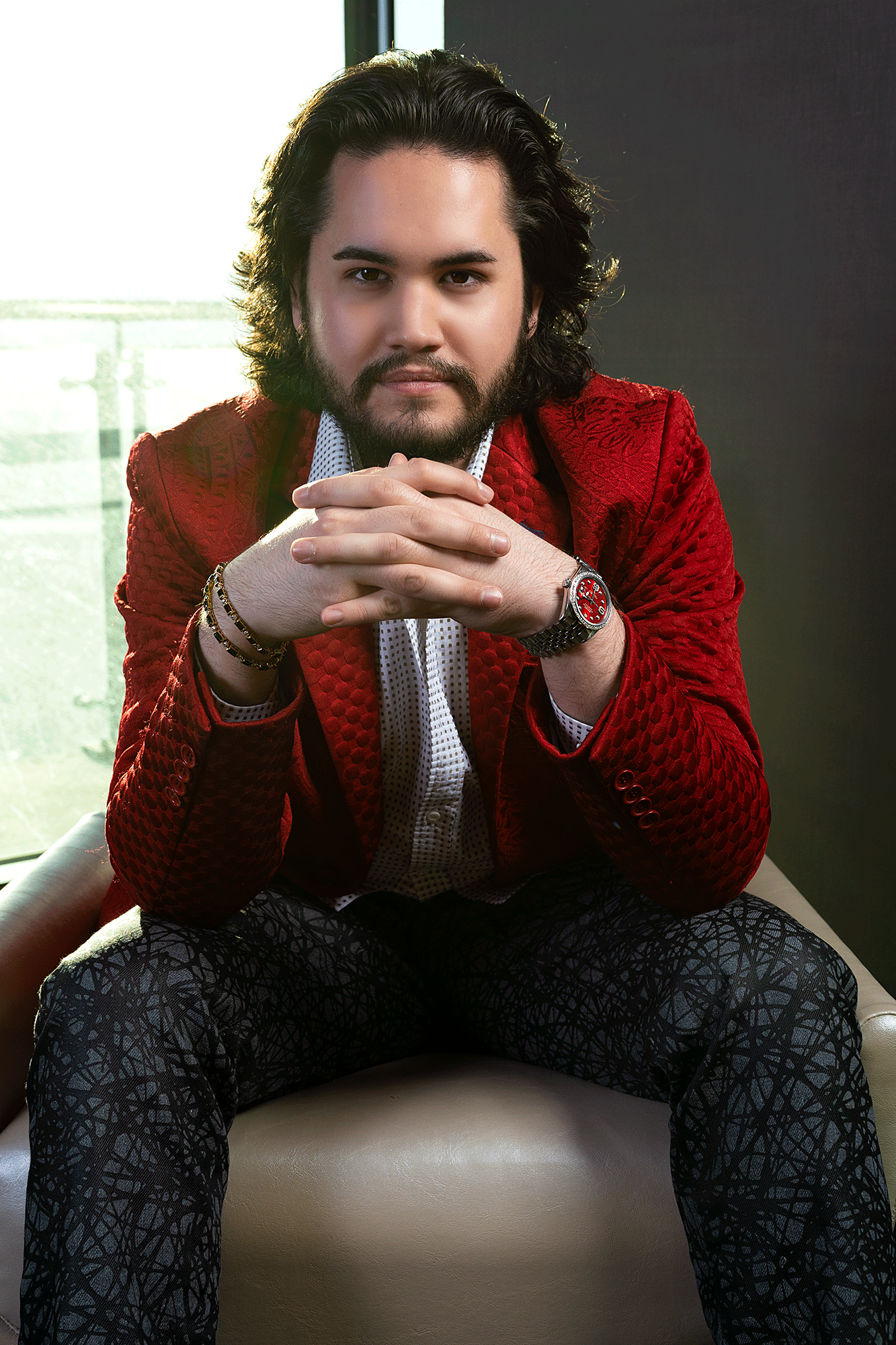 Roman Alexander Wellington In Red Couture Jacket Sitting Down
